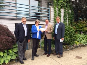 Avista Foundation drops by the office with a donation: Pictured left to right: Dennis Vermillion, Laura Haywood, Pat Lynch, and Tim McLeod.